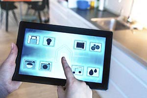 A mobile home owner remotely controlling home with tablet