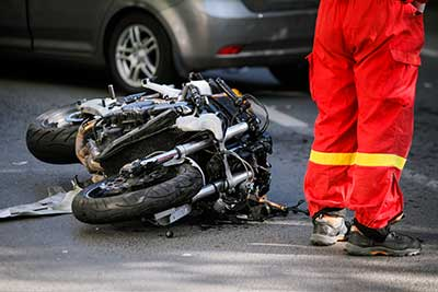 A motorcycle crashed laying on it's side in road