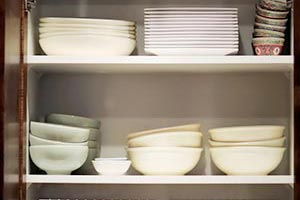 Cabinet filled with dishes and bowls